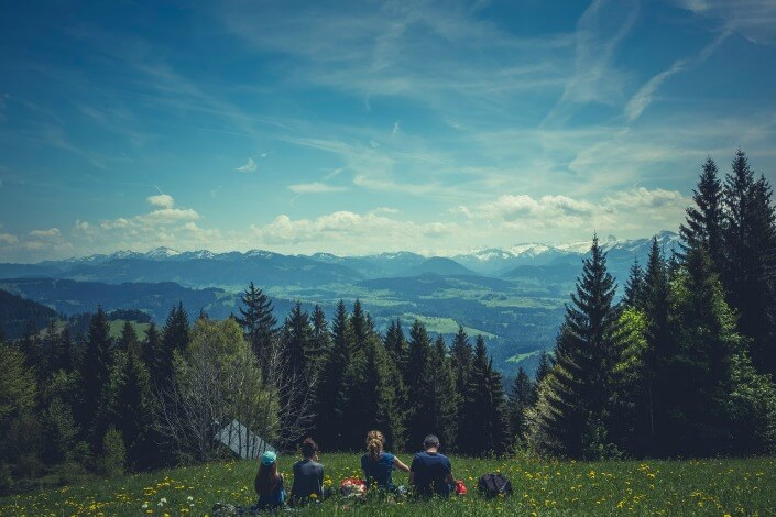 Group of friends camping in a hilly slope