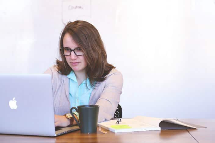 Girl reading something on her laptop.