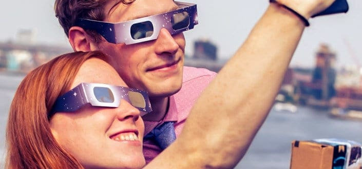 Couple wearing 3D glasses taking a photo