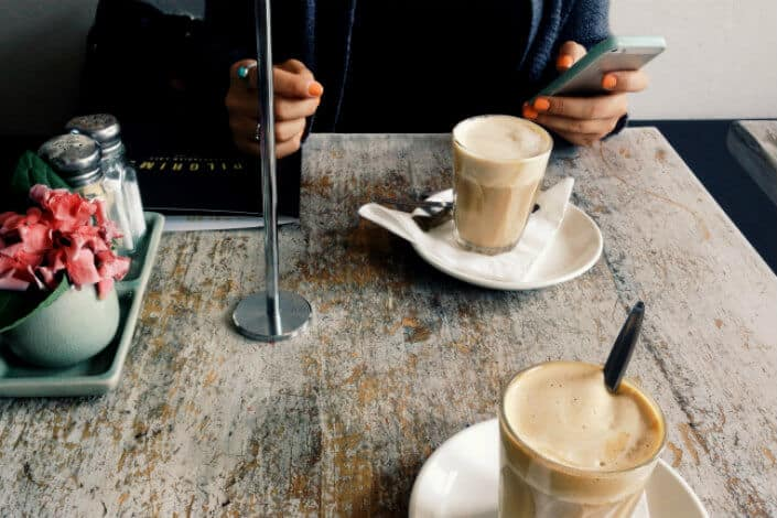 Two people sitting inside a coffee shop