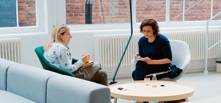 two woman doing interview