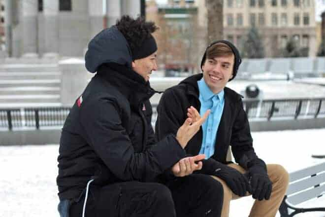 Two friends sitting on a bench. talking - random questions