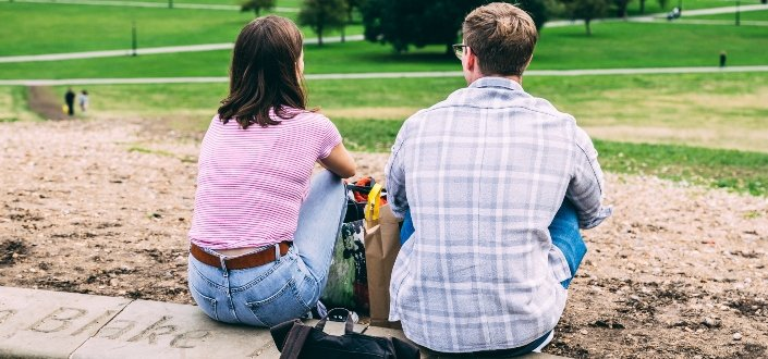 Couple sitting on the ground