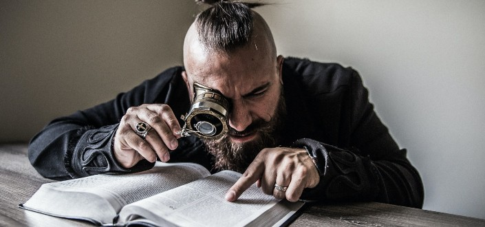 Man reading with magnifying glass