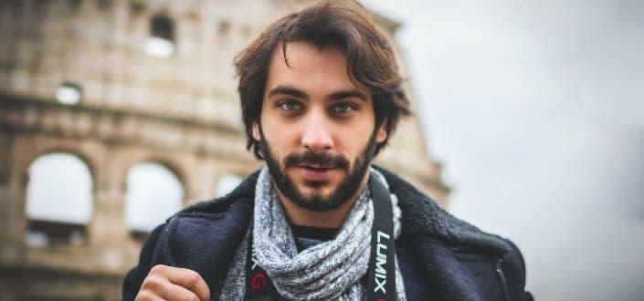 young bearded man looking at camera