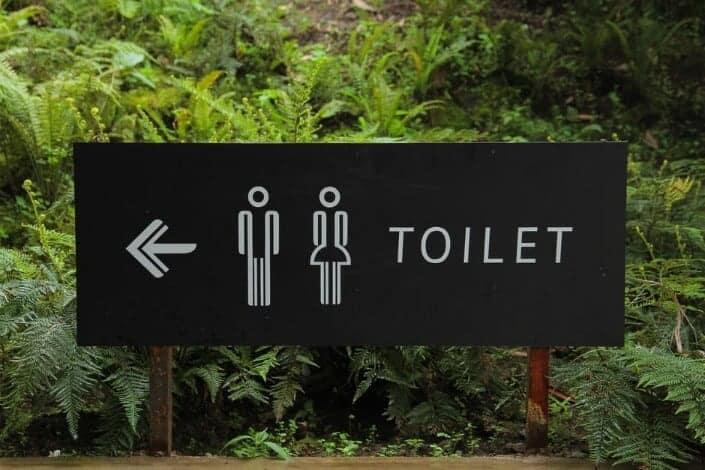A toilet locator signboard.