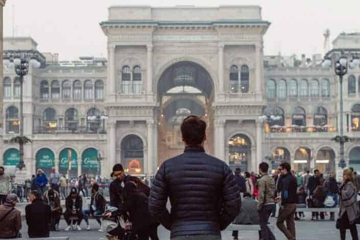 A man facing a crowd.
