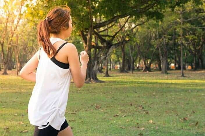 woman exercising brightly