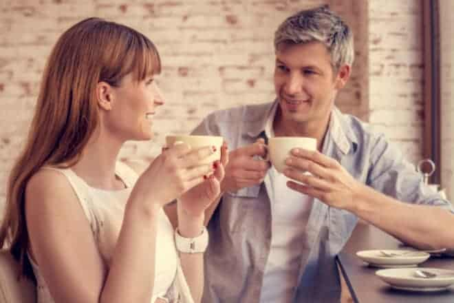 Man and woman having coffee together. - personal questions