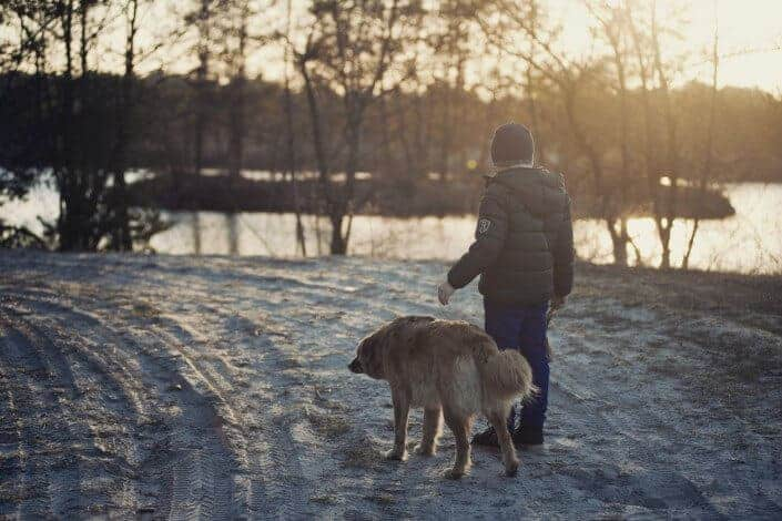 Young man walking his dog