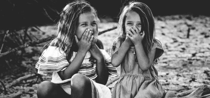Two cute little girls giggling