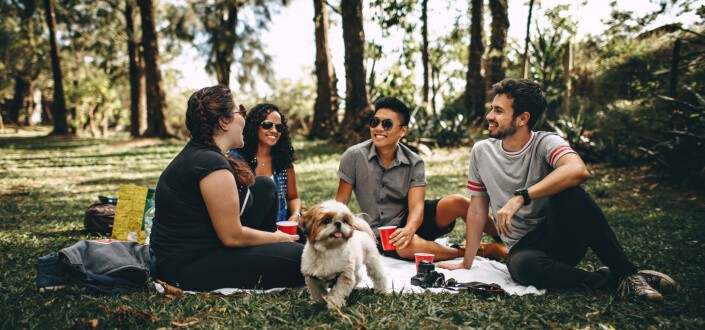 Friends in a picnic with a dog
