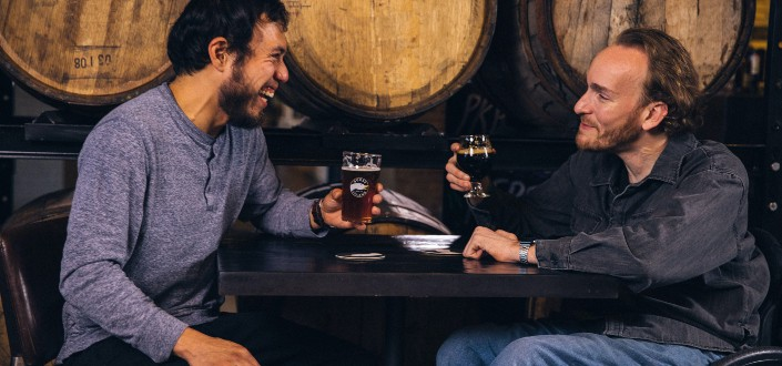 two friends laughing over drinks