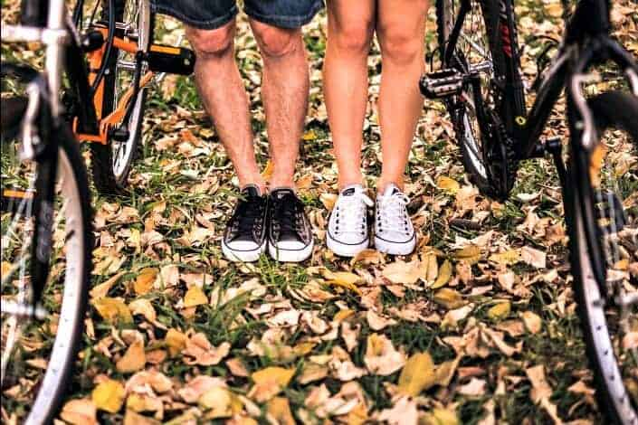Cycling couple standing side by side
