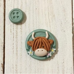 39. highland cow needle minder