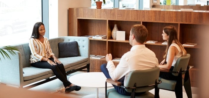 Female applicant being interviewed by recruiters