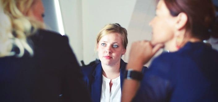 Woman attentively listening to the interviewers