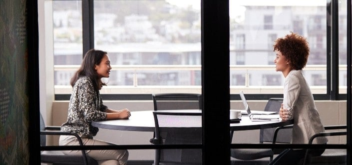 Female applicant in a one-on-one interview with a female interviewer