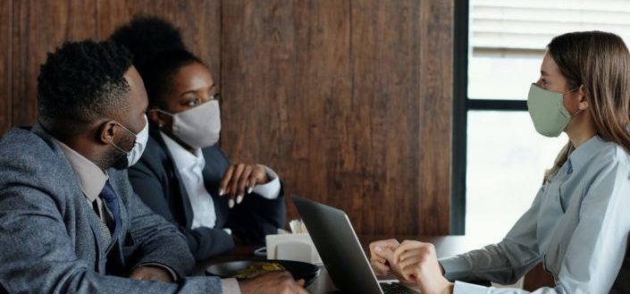 Office workers wearing face masks