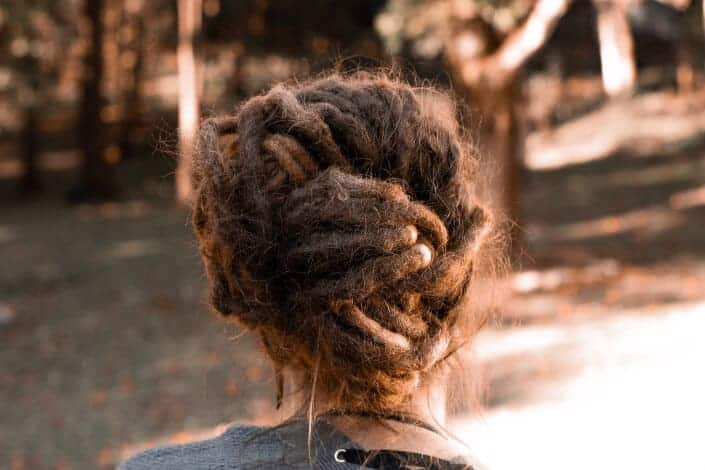 long hairstyle for men- Braid into Bun