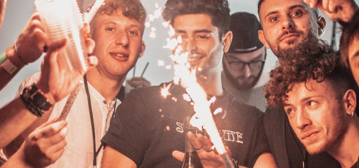 A group of men looking at sparklers