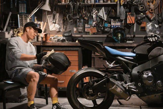 Garin Chadwick cleaning helmet and CBR 1000rr street bike in LA garage