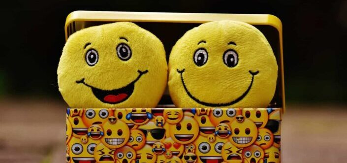 Smiley stuffed toys in a box.