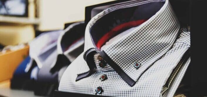 Folded men's polo on display.