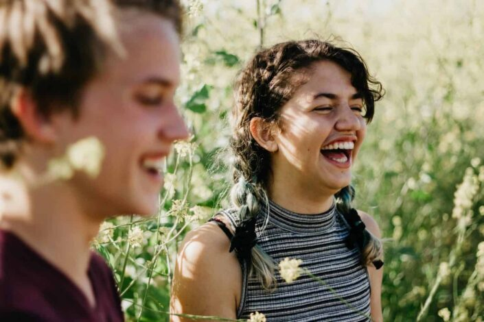 Guy and a girl laughing together.