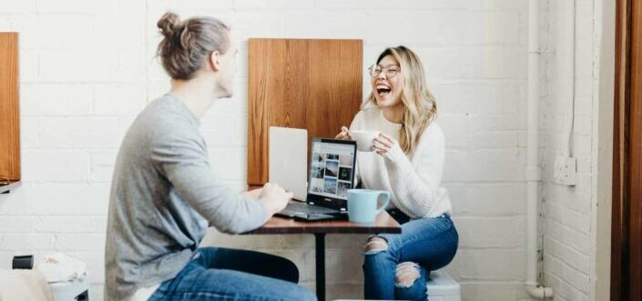 Woman laughing to a joke