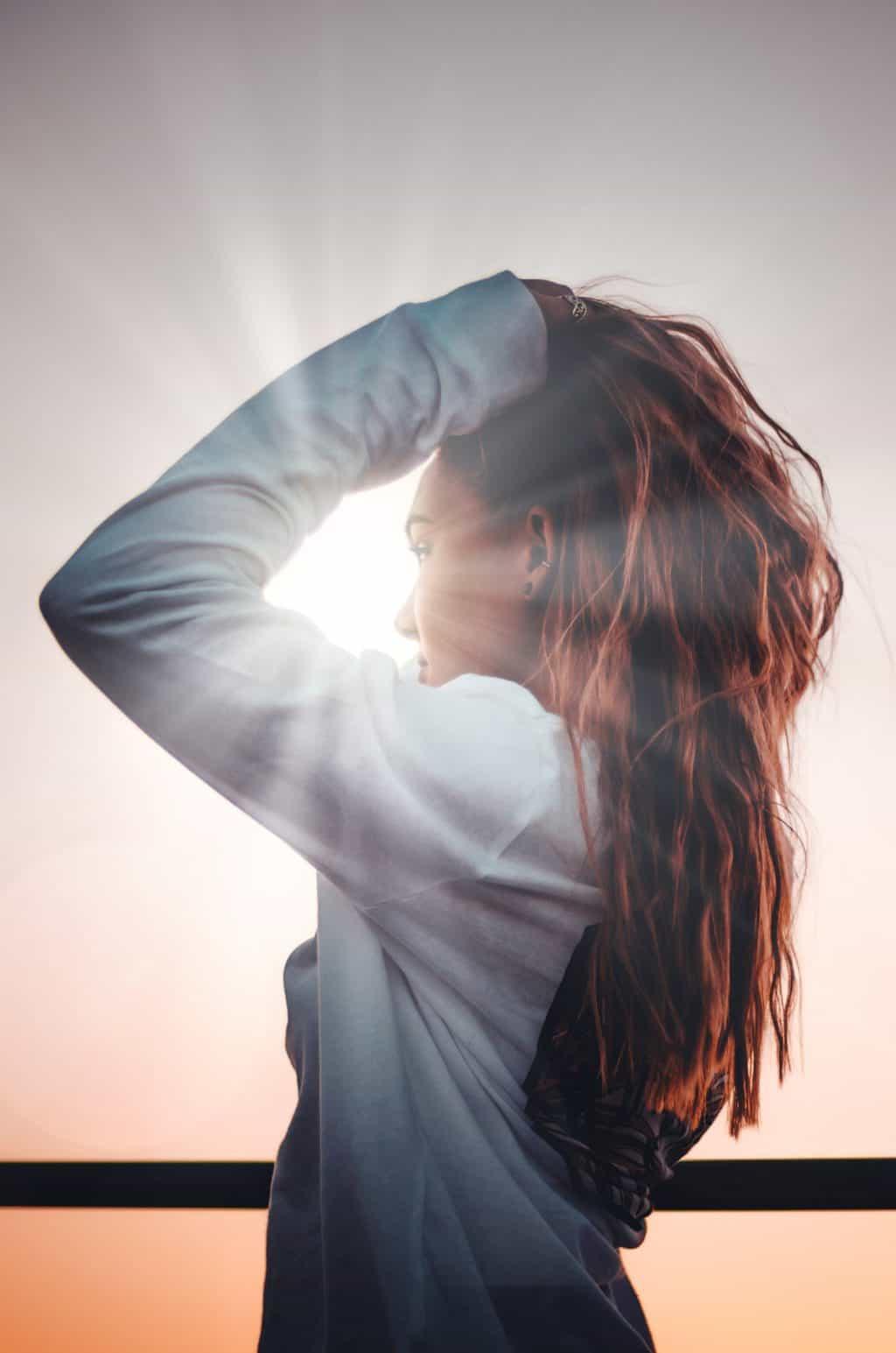 girl holding her hair up