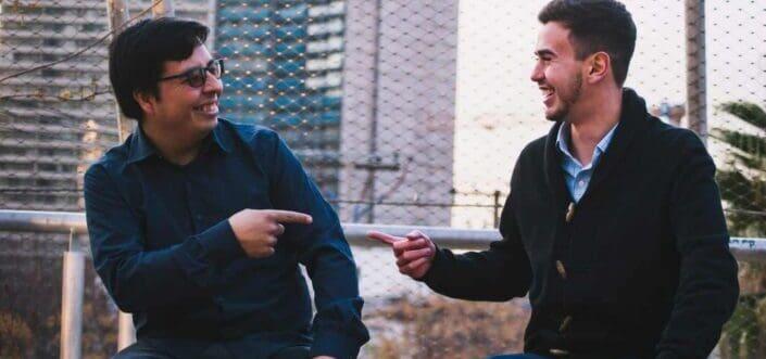 Two male friends having a fun conversation.