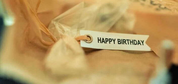 """A gift with a """"Happy birthday"""" tag."""