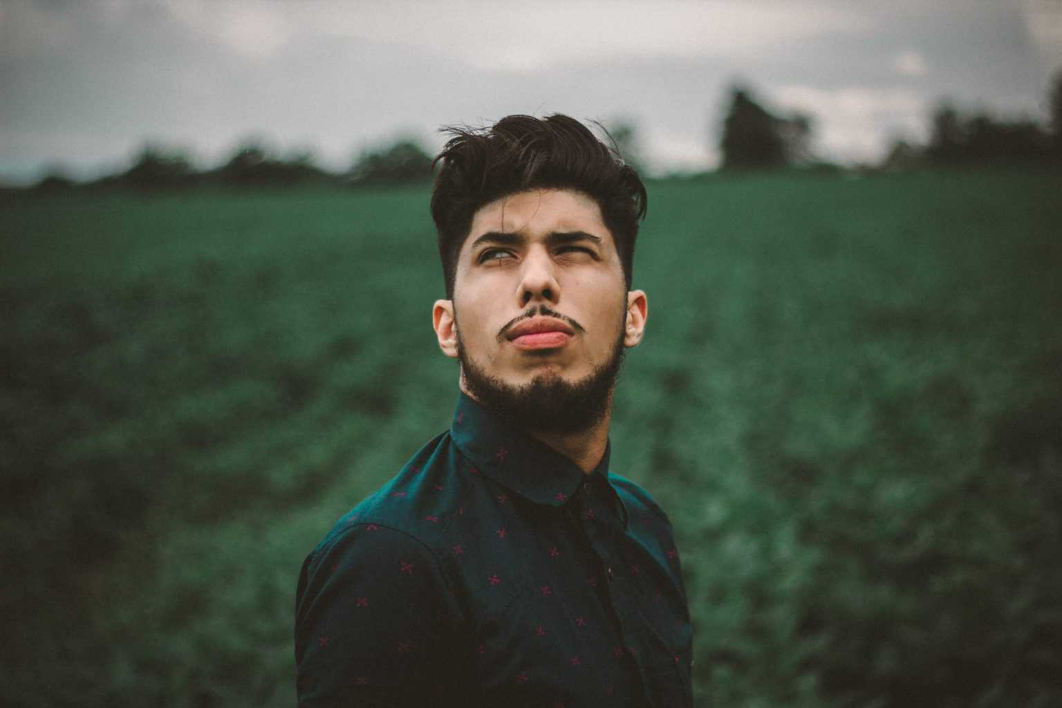 man in a field looking up