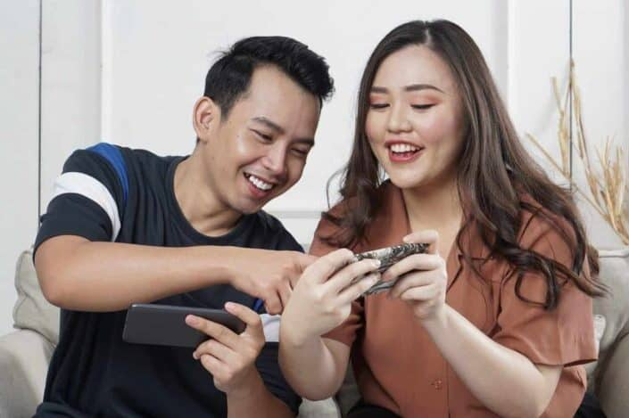 Two friends having fun on their phone