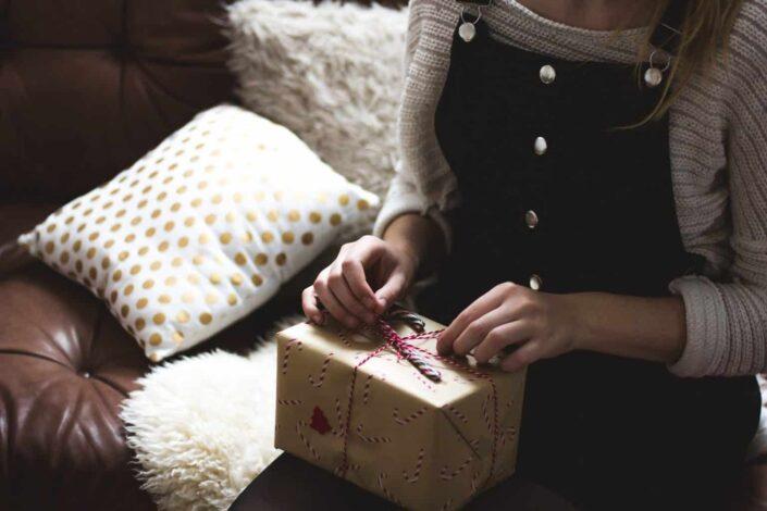 woman preparing a gift