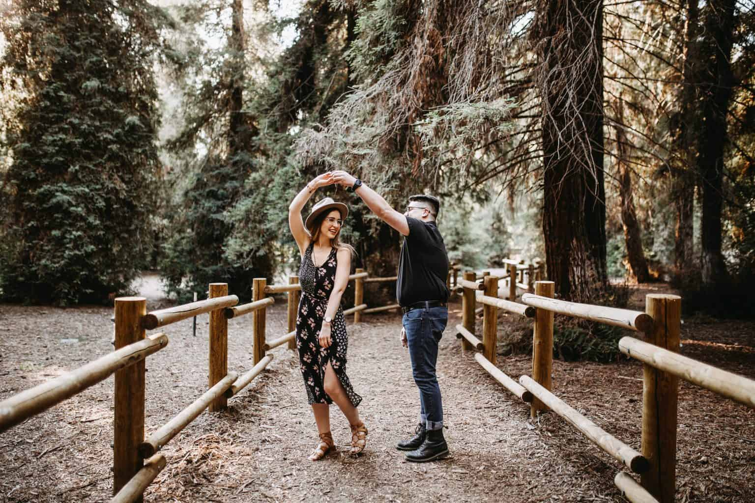 A Man and A Woman Dancing In The Middle Of The Forest
