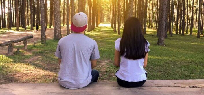 Two people looking forward at the forest