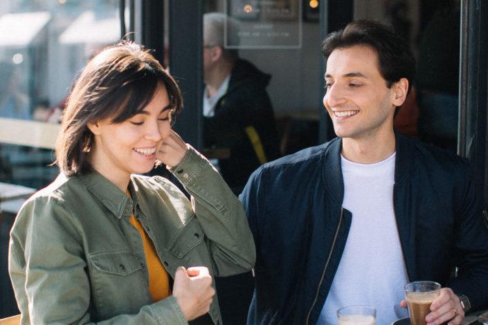 flirty moment of a couple under sunlight