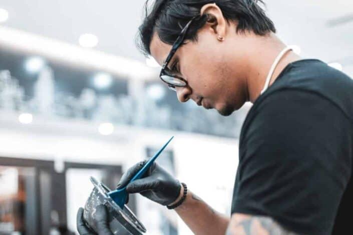 a man mixing hair dye