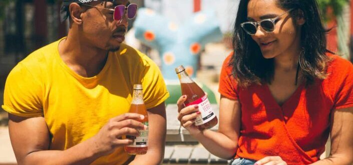 Man and woman having a drink outside