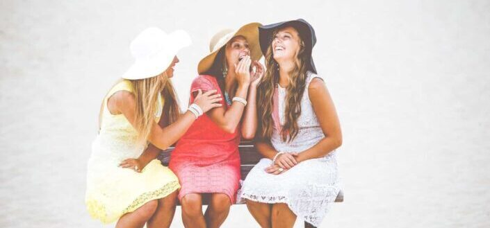 three woman laughing happily