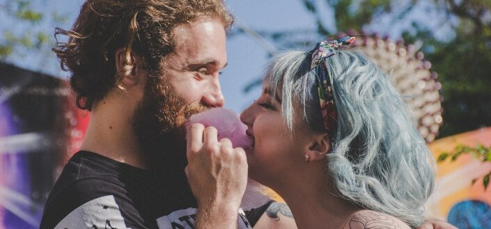 Couple biting a cotton candy