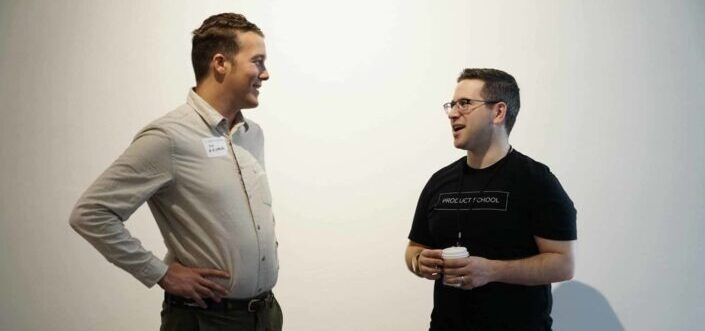 Two men casually talking