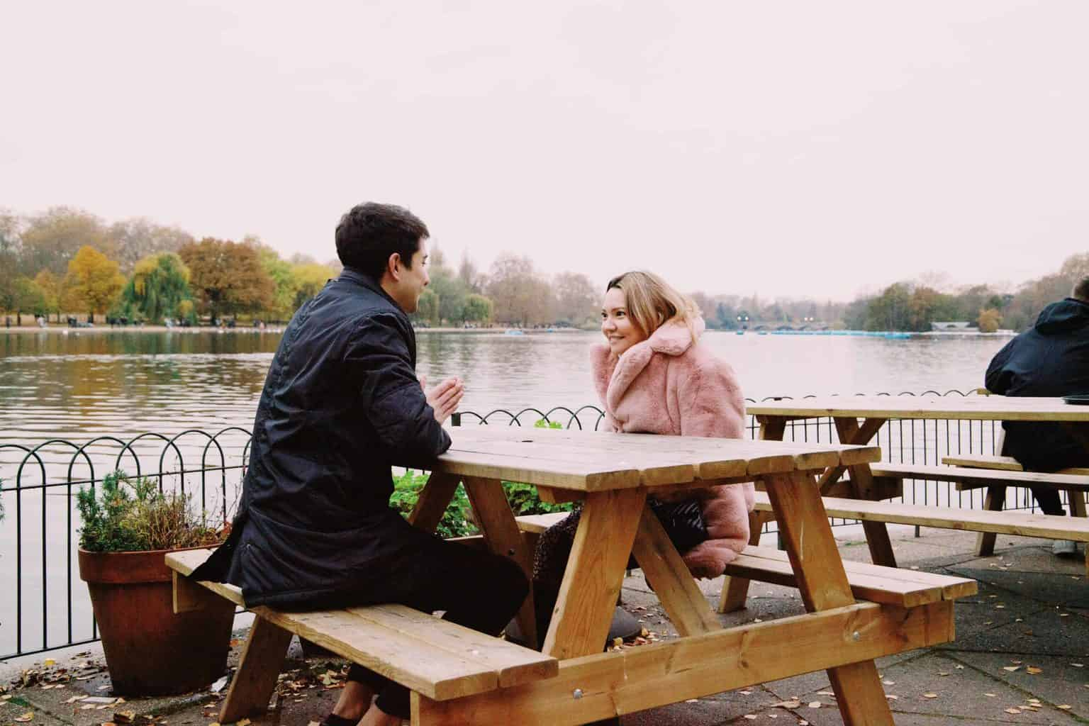 couple talking to each other by river - get to know you questions