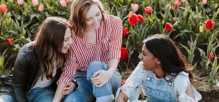 friends bonding together in a flower garden