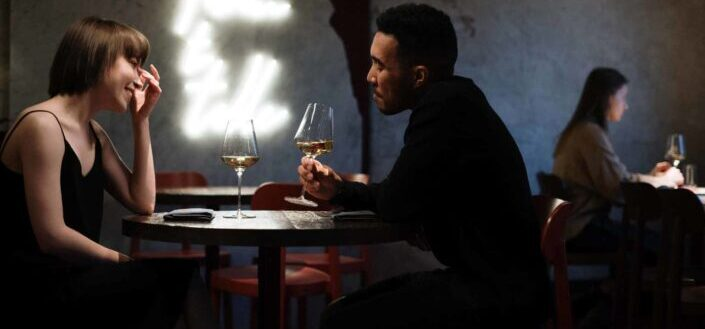 Guy and a girl dating, drinking wine.