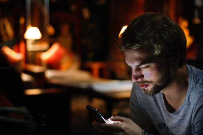 Man texting in the middle of the night.
