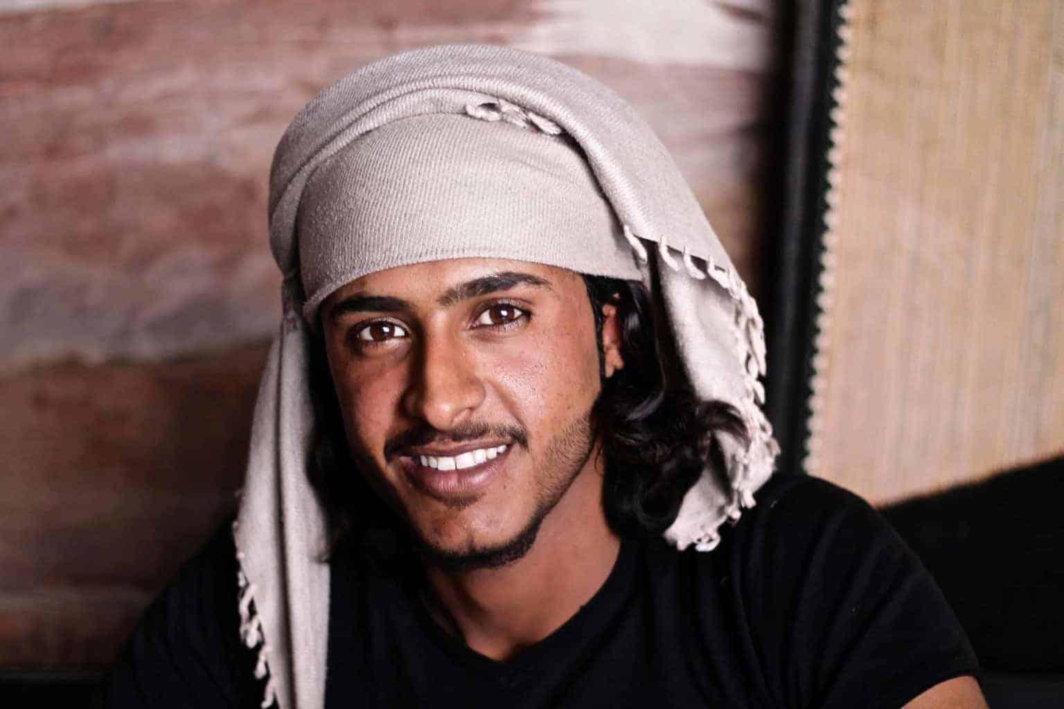 Arabic man smiling at camera