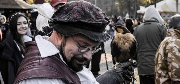 man holding a bird